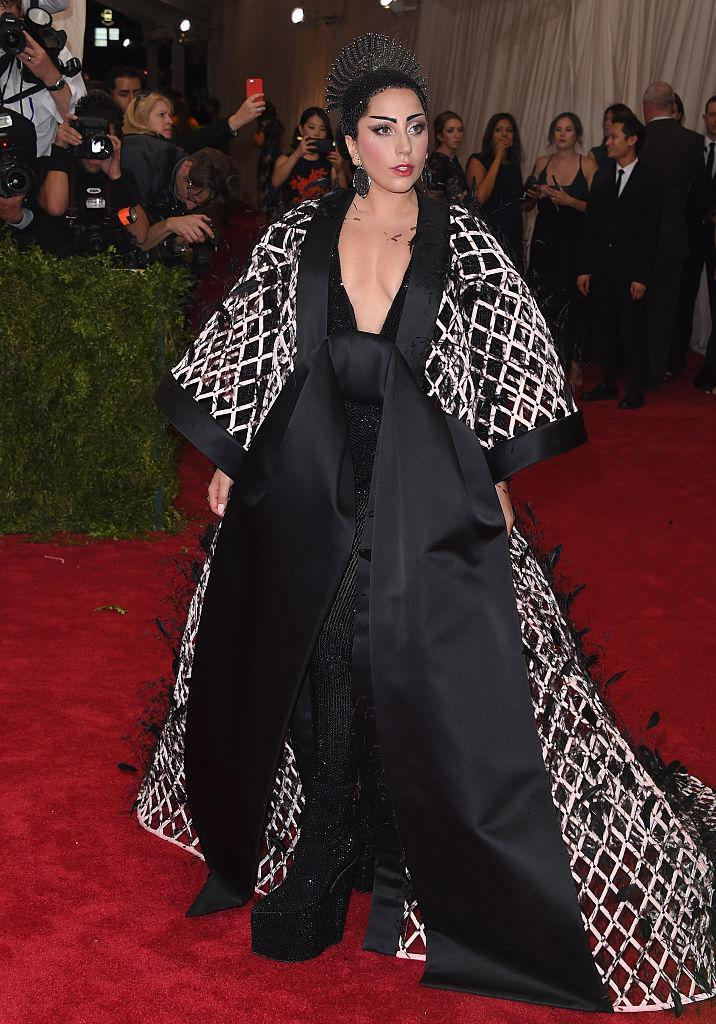 """<p>Tell me Gaga didn't wear a hybrid of a <em>Japanese</em> kimono to the """"China: Through The Looking Glass"""" themed event?! <i>(Photo via Getty Images)</i> </p>"""