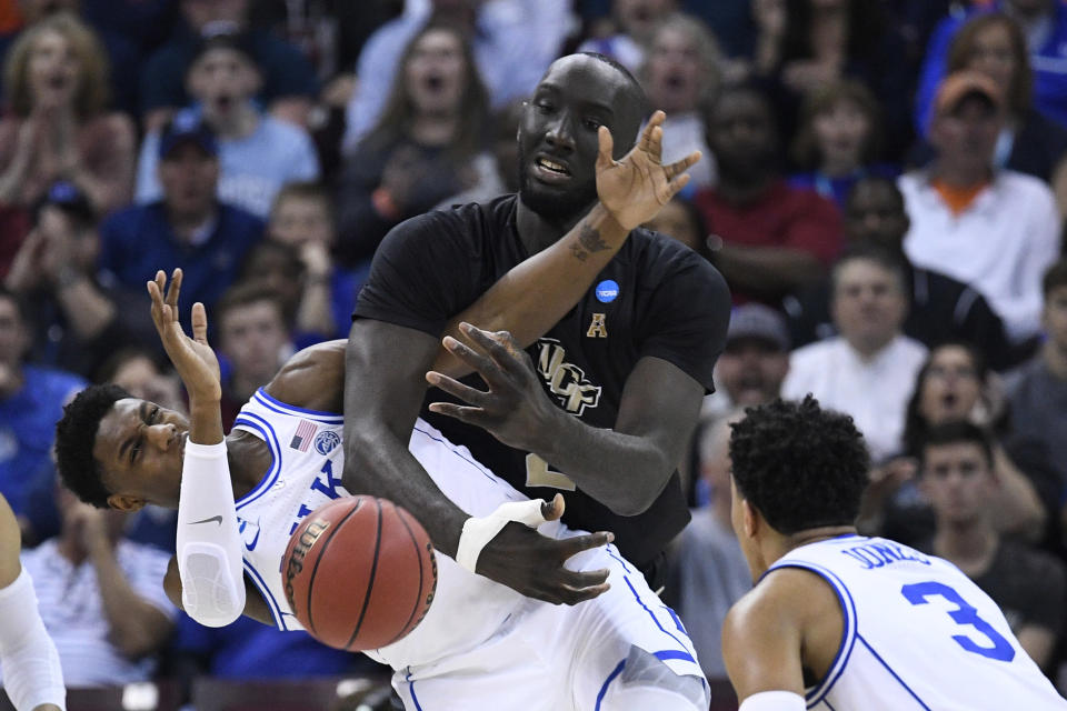 <p>RJ Barrett #5 of the Duke Blue Devils and Tacko Fall #24 of the UCF Knights compete for the ball in the second round of the 2019 NCAA Men's Basketball Tournament held at Colonial Life Arena on March 24, 2019 in Columbia, South Carolina. (Photo by Grant Halverson/NCAA Photos via Getty Images) </p>