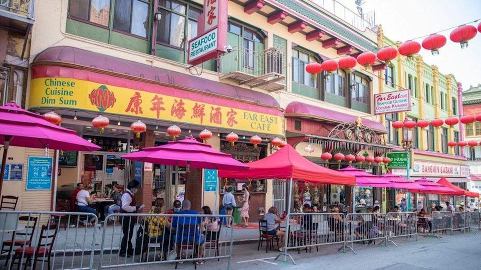 People eat outside a restaurant in San Francisco's Chinatown