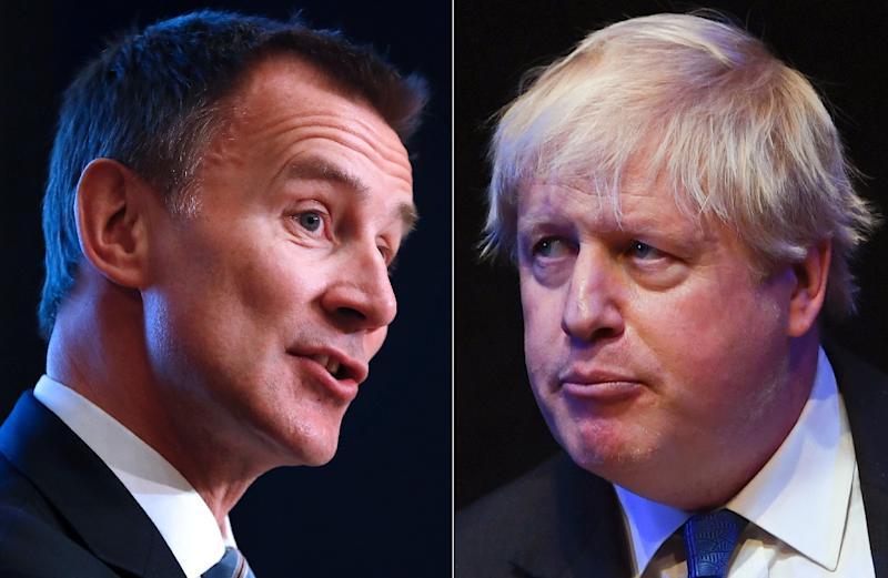 "Britain's Foreign Secretary Jeremy Hunt (L) has called on his rival Boris Johnson (R) to ""man up"" over a domestic row scandal"