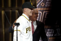 Louisville's Henry Davis stands with MLB Commissioner Rob Manfred after being selected by Pittsburgh Pirates as the number one overall pick in the first round of the 2021 MLB baseball draft, Sunday, July 11, 2021, in Denver. (AP Photo/David Zalubowski)
