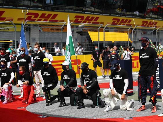 Leclerc (far left) has remained standing before races (AFP via Getty)