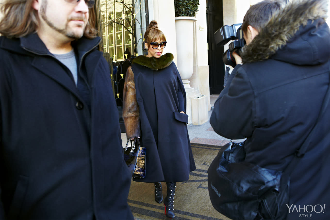 "<p>Harvey strikes a stunning pose in a Dior coat and bag on her way to the designer's couture show. <i>Photo: <a href=""http://hugueslaurent.fr/"">Hugues Laurent</a></i></p>"