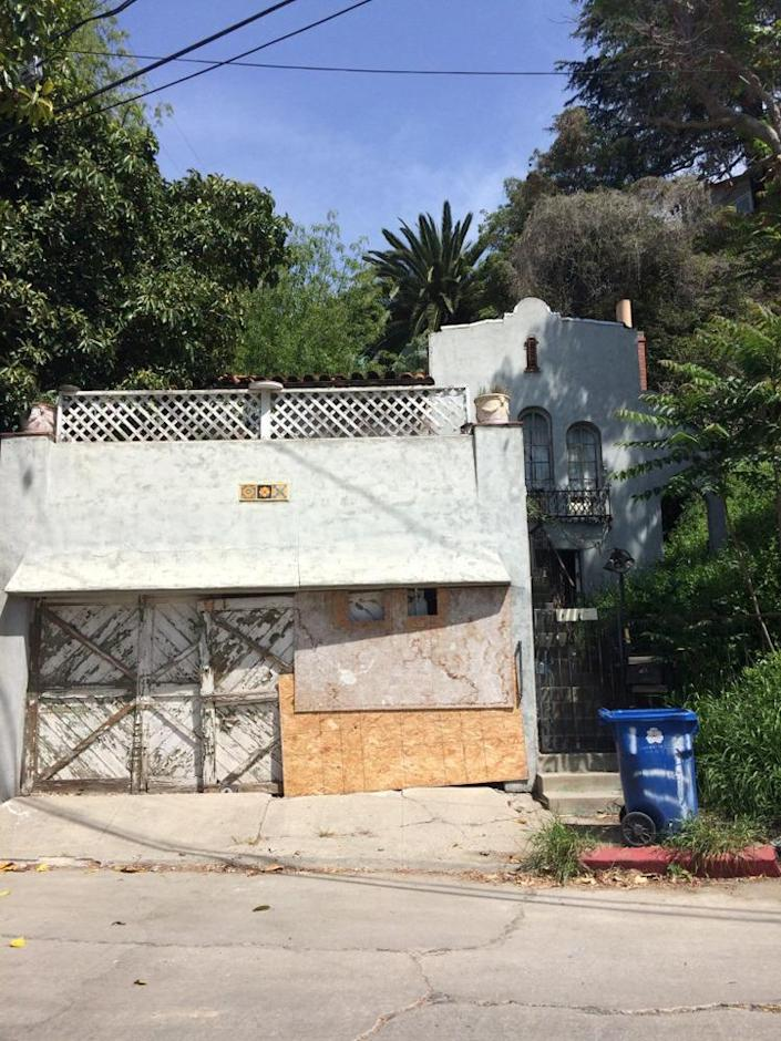 <p>The once-beautiful Spanish Revival house, built in 1928, was on death's doorstep. According to designer Hunter Kenihan, who purchased the property for its land value in 2014 and masterminded the flip, the property had been badly neglected and had racked up a number of code violations.<i> (Photo: Charmaine David for Kenihan Development)</i></p>