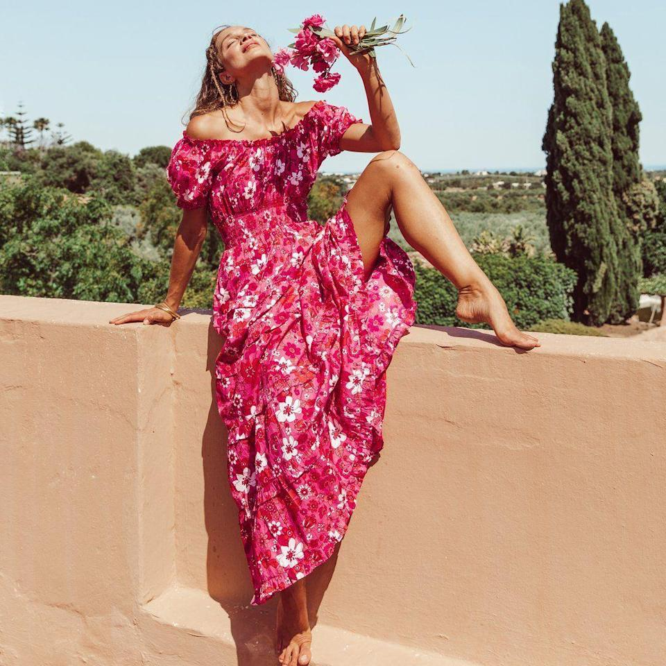 """<p><strong>Pink City Prints </strong></p><p><strong>$240.00</strong></p><p><a href=""""https://www.pinkcityprints.us/collections/dresses/products/70s-strawberry-rah-rah-dress"""" rel=""""nofollow noopener"""" target=""""_blank"""" data-ylk=""""slk:Shop Now"""" class=""""link rapid-noclick-resp"""">Shop Now</a></p><p>""""Everything about this Pink City Prints dress brings me immense joy. It's vibrant and colorful—the perfect pop of color for late summer—but the very best part is that with the right accessories it can go from easy-going to a statement in a snap.""""—<em>Roxanne Adamiyatt, Senior Lifestyle Editor </em></p>"""