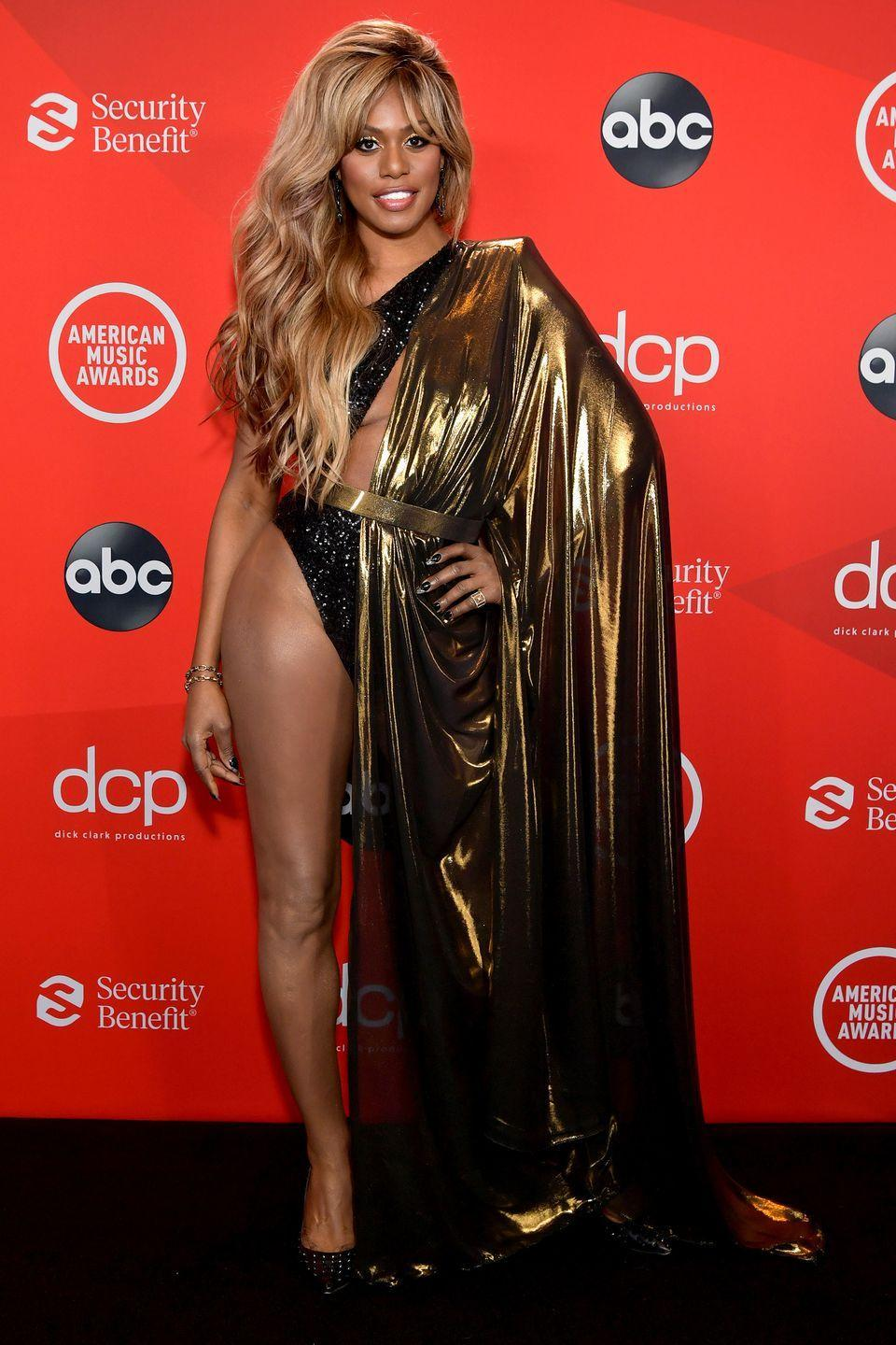 <p><strong>22 November </strong>Laverne Cox stole the show in a sequinned body suit with a draped gold cape by Michael Costello. </p>
