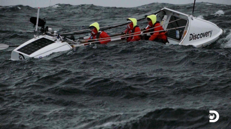 "This image released by Discovery shows a scene from ""The Impossible Row,"" documenting endurance athlete Colin O'Brady and his crew's crossing of the treacherous icy waters of The Drake Passage by row boat. Located between the Southern tip of South America and the edge of Antarctica the Drake Passage is considered one of the most terrifying and dangerous sea paths in the world. They finished crossing the Drake Passage in 13 days. (Discovery via AP)"