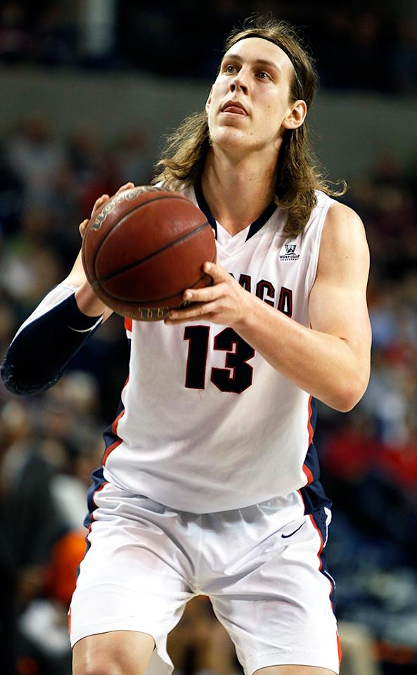 Kelly Olynyk #13 of the Gonzaga Bulldogs takes a foul shot during the second half of the game against the Pepperdine Waves at McCarthey Athletic Center on February 7, 2013 in Spokane, Washington.  (Photo by William Mancebo/Getty Images)