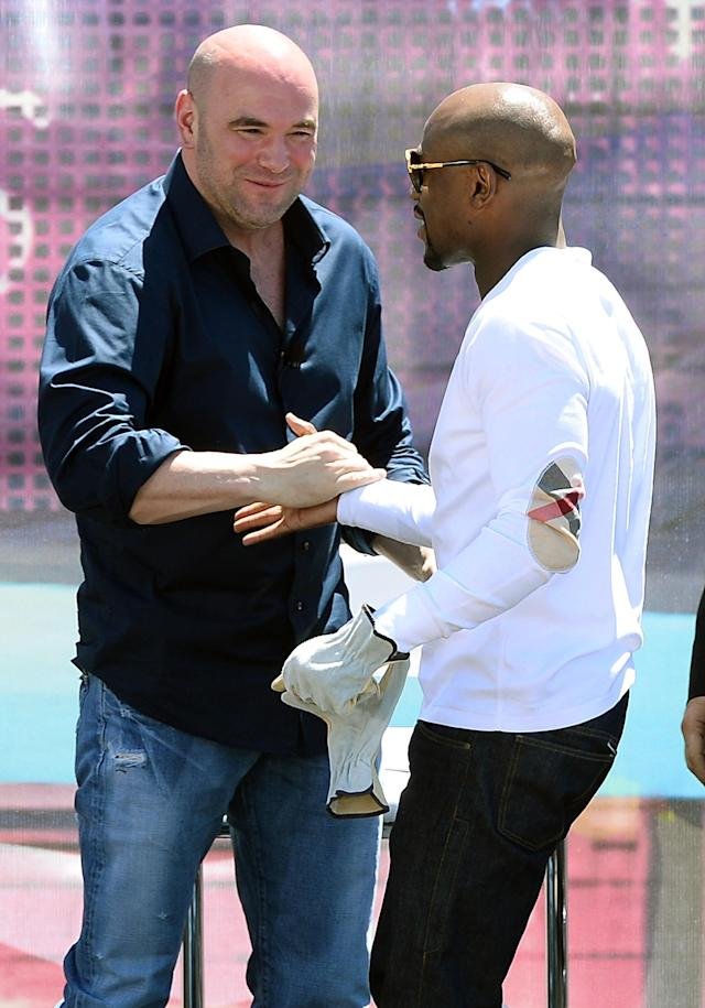 LAS VEGAS, NV - MAY 01: UFC President Dana White (L) greets WBC welterweight champion Floyd Mayweather Jr. during a groundbreaking for a USD 375 million, 20,000-seat sports and entertainment arena being built by MGM Resorts International and AEG on May 1, 2014 in Las Vegas, Nevada. The arena is scheduled to open in early 2016. (Photo by Ethan Miller/Getty Images for MGM Resorts)