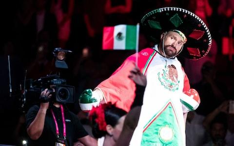 <span>Fury entered the ring wearing Mexican national colours to celebrate Mexican Independence Day</span> <span>Credit: Rex </span>