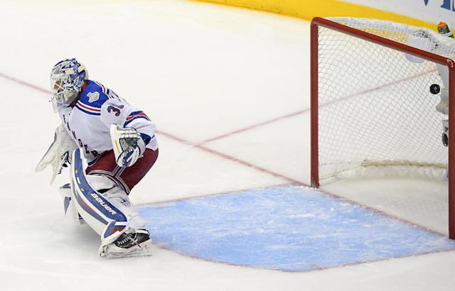 New York Rangers goalie Henrik Lundqvist, of Sweden, can't stop Los Angeles Kings right wing Justin Williams overtime goal in Game 1 of the NHL hockey Stanley Cup Finals, Wednesday, June 4, 2014, in Los Angeles. (AP Photo/Mark J. Terrill)