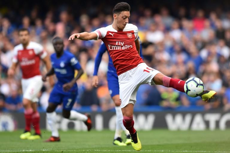 Arsenal's German midfielder  Mesut Ozil returned to the team against Cardiff