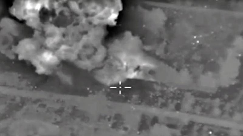 A video grab made on October 14, 2015, purports to show explosions after Russian airstrikes on an Islamic State facility in the vicinity of the city of Aleppo