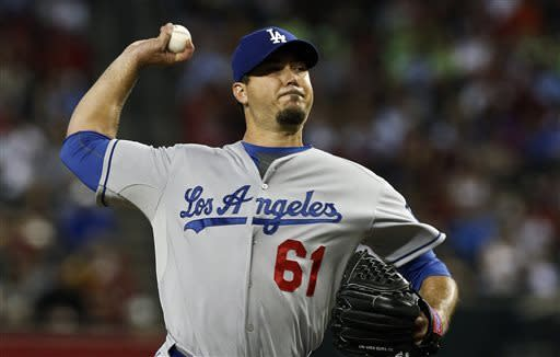 Los Angeles Dodgers' Josh Beckett throws against the Arizona Diamondbacks during the first inning in a baseball game on Sunday, April 14, 2013, in Phoenix. (AP Photo/Ross D. Franklin)