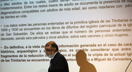 Forensic archaeologist Francisco Etxeberria walks past a projection of the conclusions about the search for Spanish writer Miguel de Cervantes' remains, in Madrid March 17, 2015. REUTERS/Andrea Comas