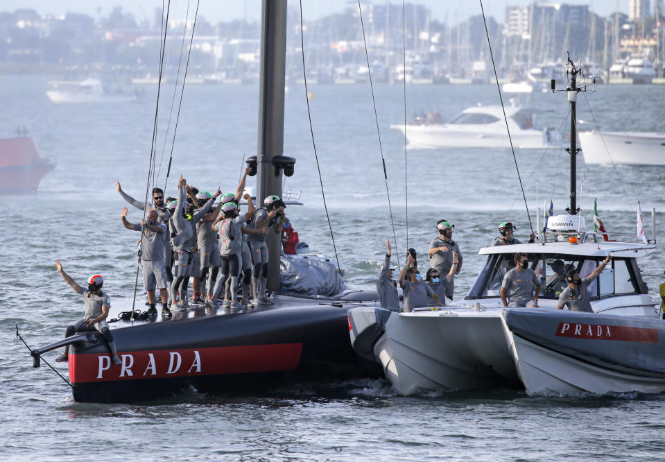 Italy's Luna Rossa team celebrate after defeating Britain's INEOS Team UK in race eight of the Prada Cup on Auckland's Waitemata Harbour, New Zealand, Sunday, Feb.21, 2021.Italian challenger Luna Rossa Prada Pirelli will race defender Emirates Team New Zealand in the 36th match for the America's Cup after beating Britain's Ineos Team UK in two races Sunday to seal a 7-1 win in the best-of-13 race challengers series final. (Alex Burton/NZ Herald via AP)