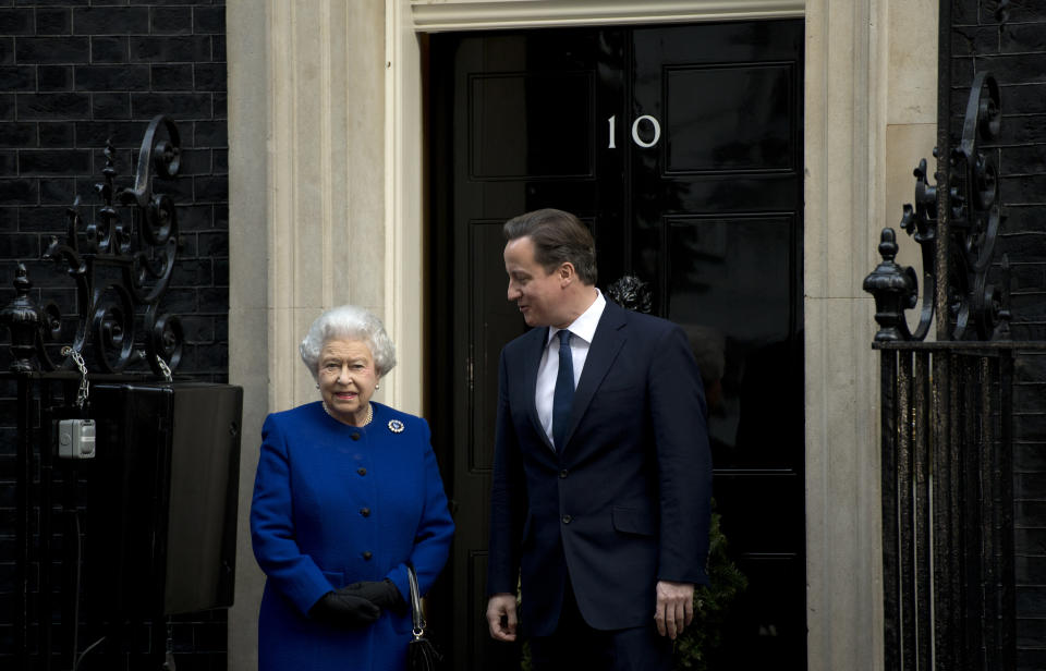 Britain's Prime Minister David Cameron (R) greets Queen Elizabeth II (L) outside No 10 Downing Street in London December 18, 2012 as she arrives to attend the meeting of the Cabinet. Queen Elizabeth II attended her first-ever cabinet meeting on Tuesday to mark her diamond jubilee, the only monarch to do so since 1781.The 86-year-old sovereign sat in as an observer on the meeting and received a gift from the Cabinet to celebrate her 60 years on the throne. AFP PHOTO / ADRIAN DENNIS        (Photo credit should read ADRIAN DENNIS/AFP via Getty Images)