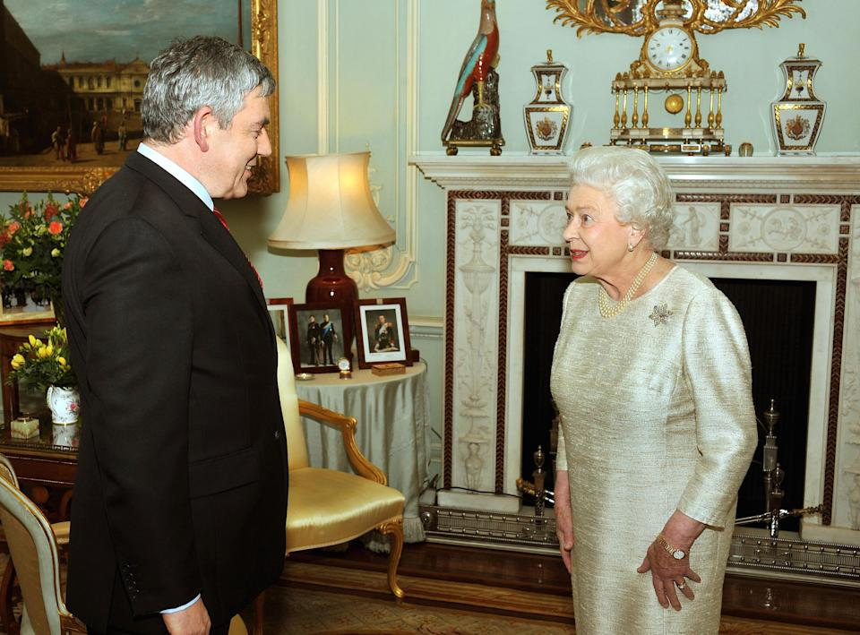 Britain's Queen Elizabeth II greets Gordon Brown at Buckingham Palace for an audience at which he tended his resignation as Prime Minister.