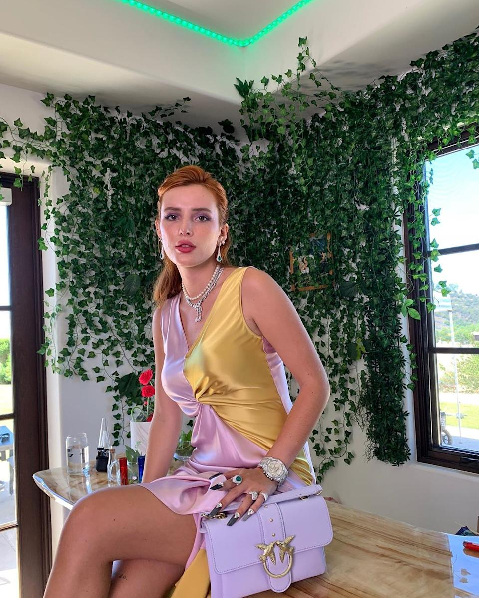 Bella Thorne poses for photo