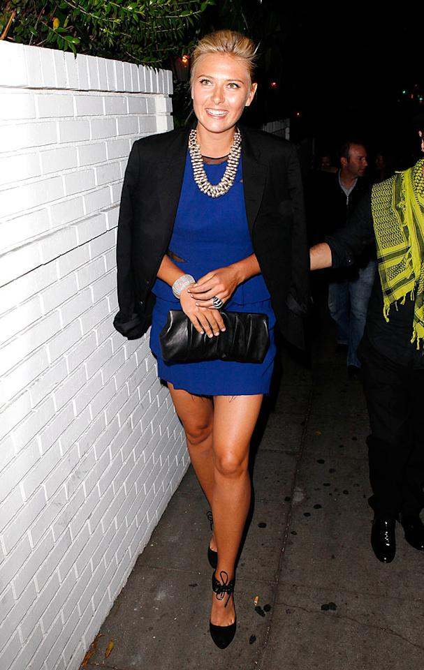"""Tennis ace Maria Sharapova showed some leg and a lot of bling as she sashayed to a Cole Haan dinner in a blue Thakoon mini, black strappy heels, silver Dries van Noten statement necklace, and her signature smile. <a href=""""http://www.x17online.com"""" target=""""new"""">X17 Online</a> - April 7, 2009"""