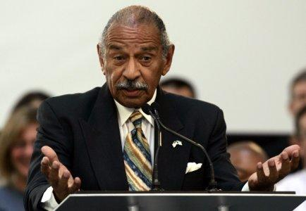 File Picture: U.S. Representative John Conyers addresses the audience during a program to announce the first round of loan commitments to transform older factories during a news conference at the Ford Motor Research & Innovation Center in Dearborn, Michigan June 23, 2009. REUTERS/Rebecca Cook