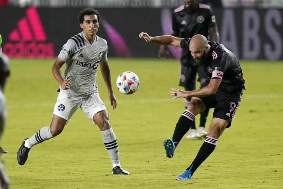 Inter Miami forward Gonzalo Higuain (9) kicks the ball as Montreal midfielder Ahmed Hamdi watches during the first half of an MLS soccer match Wednesday, May 12, 2021, in Fort Lauderdale, Fla. (AP Photo/Lynne Sladky)