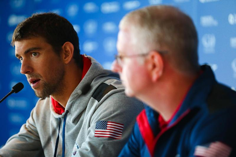 US swimmer Michael Phelps (L) and his coach Bob Bowman take part in a press conference at the Gold Coast Aquatic Centre in Queenland, Australia, on August 20, 2014