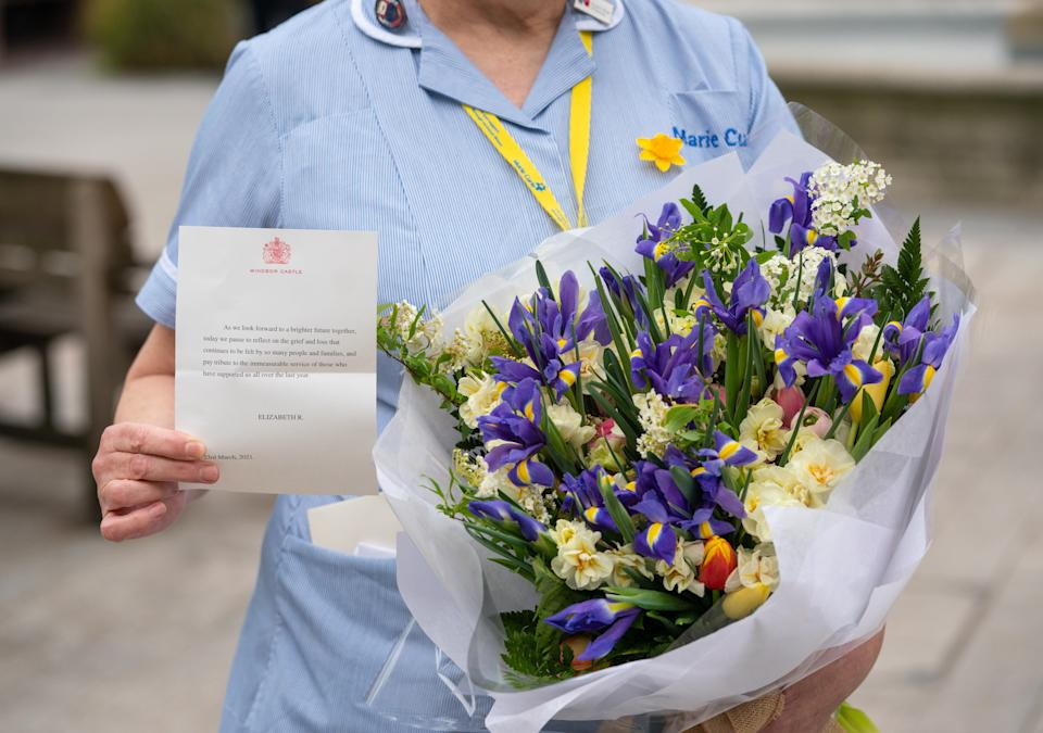 General view of flowers from Queen Elizabeth II to staff at St Bartholomew's Hospital, London, on the anniversary of the first national lockdown to prevent the spread of coronavirus. Picture date: Tuesday March 23, 2021. (Photo by Dominic Lipinski/PA Images via Getty Images)