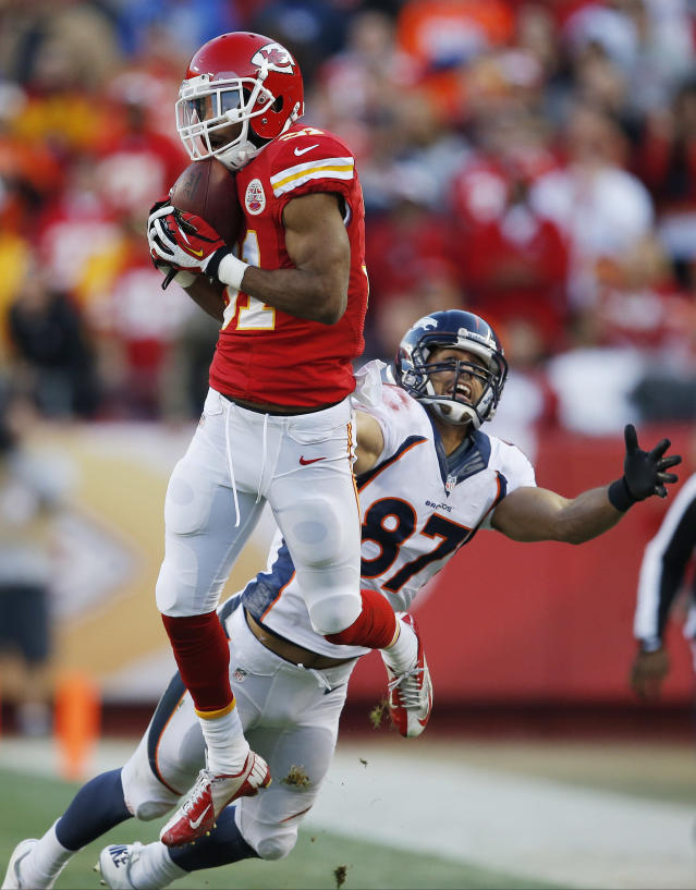 Kansas City Chiefs cornerback Marcus Cooper (31) intercepts a pass intended for Denver Broncos wide receiver Eric Decker (87) during the first half of an NFL football game, Sunday, Dec. 1, 2013, in Kansas City, Mo. (AP Photo/Orlin Wagner)
