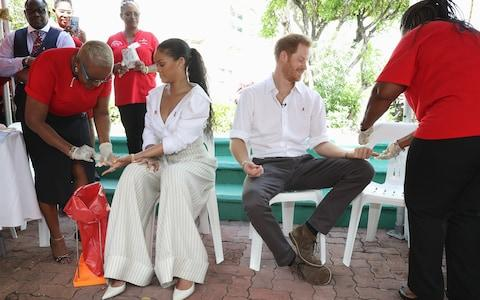 Rihanna and Prince Harry have blood samples taken for a HIV test, on a different occasion - Credit: Chris Jackson/Getty Images