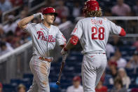 Philadelphia Phillies J.T. Realmuto celebrates with teammate Alec Bohm (28) after scoring a home run during the seventh inning of a baseball game against the Washington Nationals in Washington, Tuesday, Aug. 3, 2021. (AP Photo/Manuel Balce Ceneta)