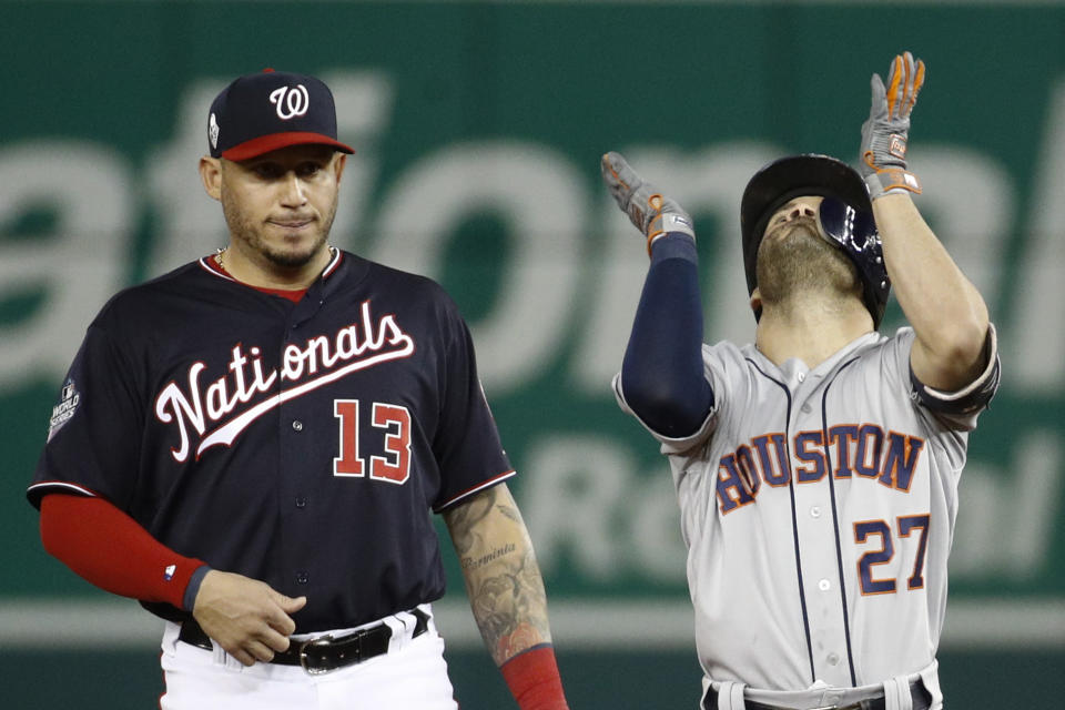 Houston Astros' Jose Altuve, right, celebrates next to Washington Nationals second baseman Asdrubal Cabrera after a double during the fifth inning of Game 3 of the baseball World Series Friday, Oct. 25, 2019, in Washington. (AP Photo/Patrick Semansky)