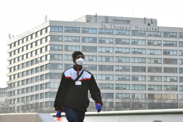 A man wearing a face mask walks in central London (Picture: Getty)