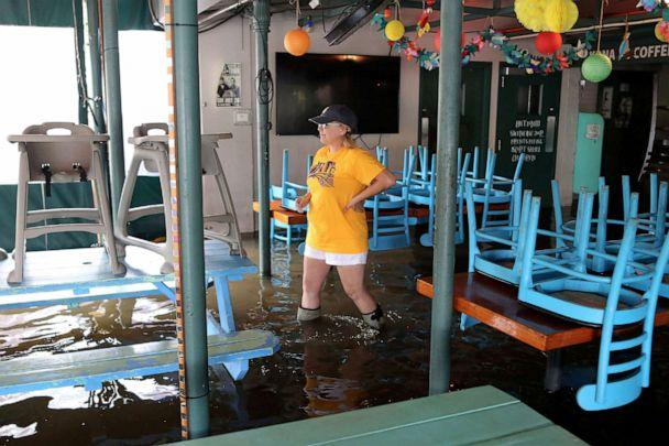 PHOTO:A woman walks through her flooded business during Hurricane Barry in Mandeville, Louisiana, July 13, 2019. (Jonathan Bachman/Reuters)