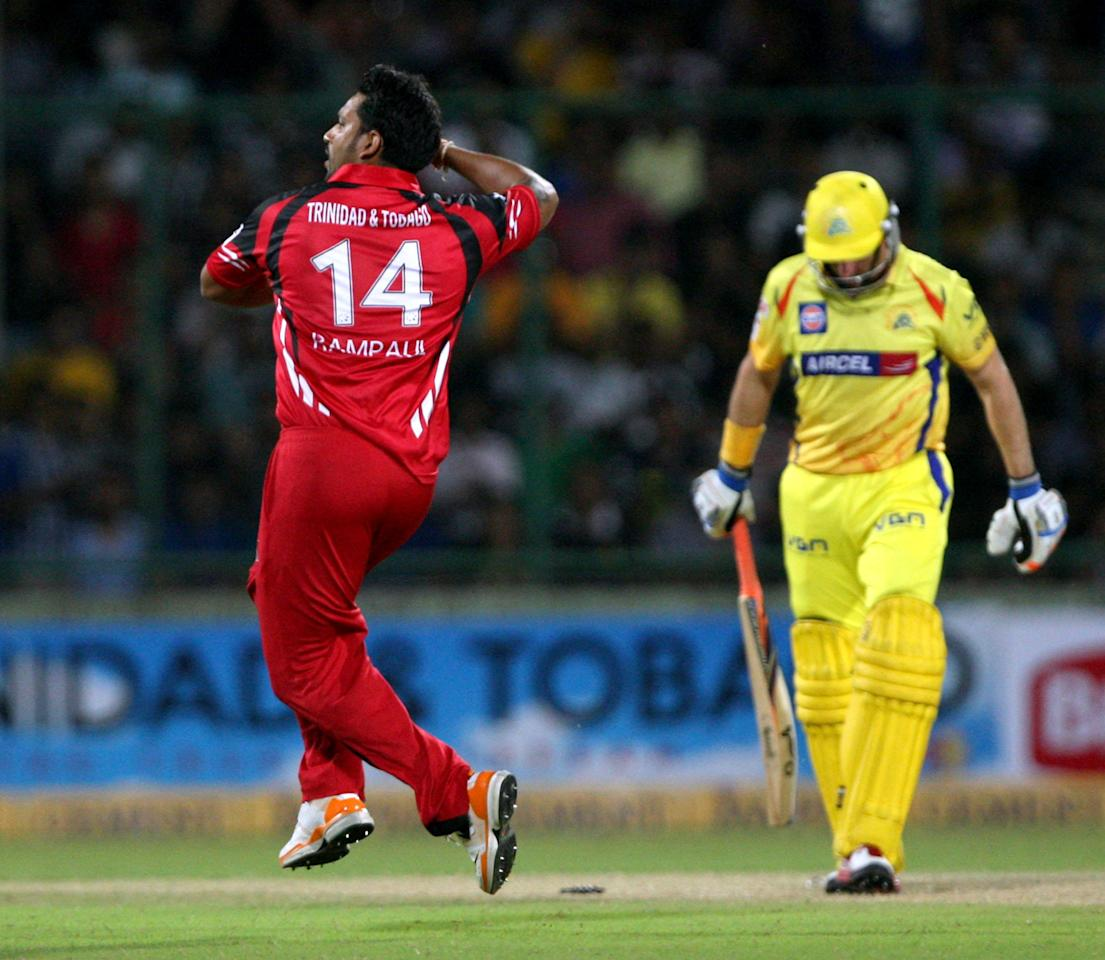 T&T's Ravi Rampaul celebrates after taking wicket of Michael Hussey during the CLT20 match between Chennai Super Kings and Trinidad & Tobago at Feroz Shah Kotla, Delhi on Oct. 2, 2013. (Photo: IANS)