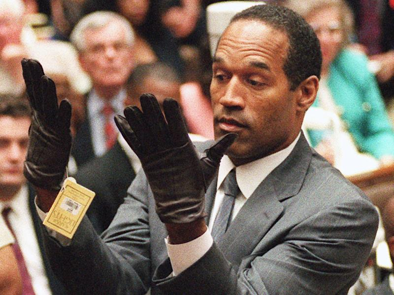 FILE - In this Wednesday, June 21, 1995 file photo, O.J. Simpson holds up his hands before the jury after putting on a new pair of gloves similar to the infamous bloody gloves during his double-murder trial in Los Angeles. The return of O.J. Simpson to a Las Vegas courtroom next Monday, May, 13, will remind Americans of a tragedy that became a national obsession and in the process changed the country's attitude toward the justice system, the media and celebrity. (AP Photo/Vince Bucci, Pool, File)