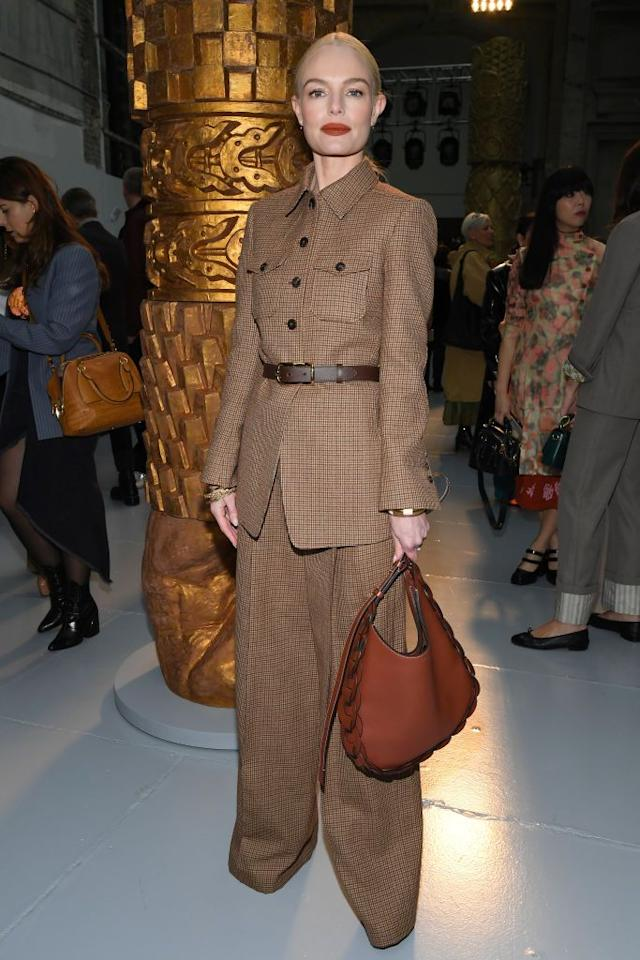 <p>The actor wore a brown checked suit for PFW.</p>