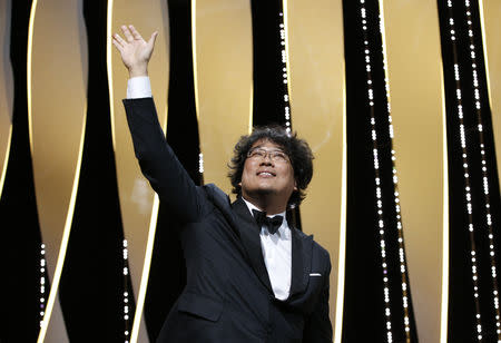 """72nd Cannes Film Festival - Closing ceremony - Cannes, France, May 25, 2019. Director Bong Joon-ho, Palme d'Or award winner for his film """"Parasite"""" (Gisaengchung), reacts. REUTERS/Stephane Mahe"""