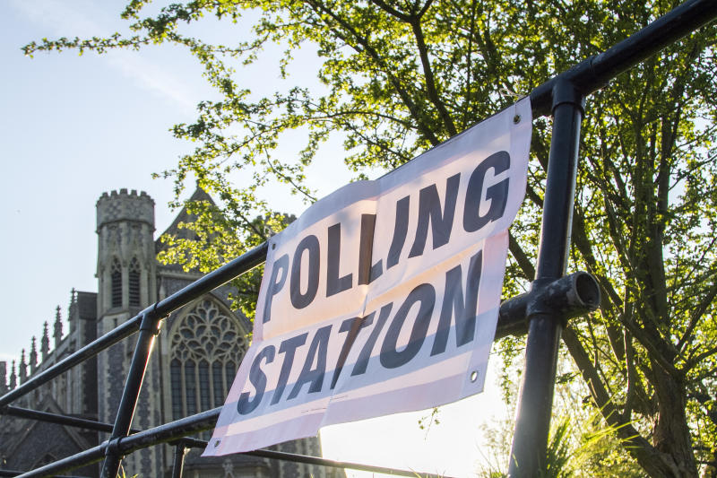 A polling station sign in London attached to a metal barrier. Image: Getty