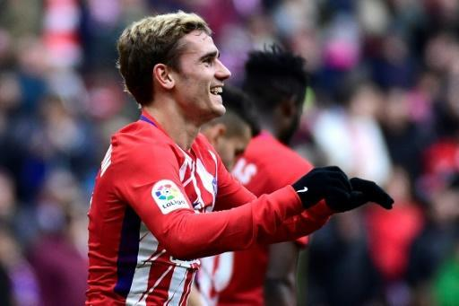 Atletico Madrid's forward Antoine Griezmann celebrates after scoring a goal during the Spanish league football match against Girona January 20, 2018