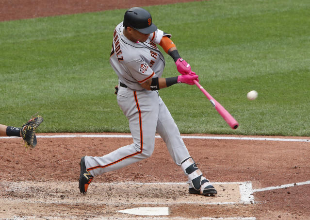 San Francisco Giants' Gorkys Hernandez hits a solo home run off Pittsburgh Pirates starting pitcher Ivan Nova in the sixth inning of a baseball game in Pittsburgh, Sunday, May 13, 2018. (AP Photo/Gene J. Puskar)