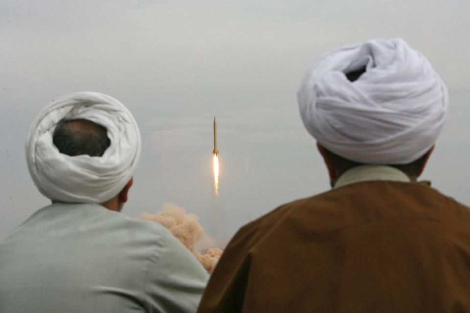 Iranian clergymen watch a Shahab-3 long-range ballistic missile fird by Iran's Revolutionary Guards in the desert outside the holy city of Qom, Nov. 2, 2006. (Photo: Stringer/AFP/Getty Images)