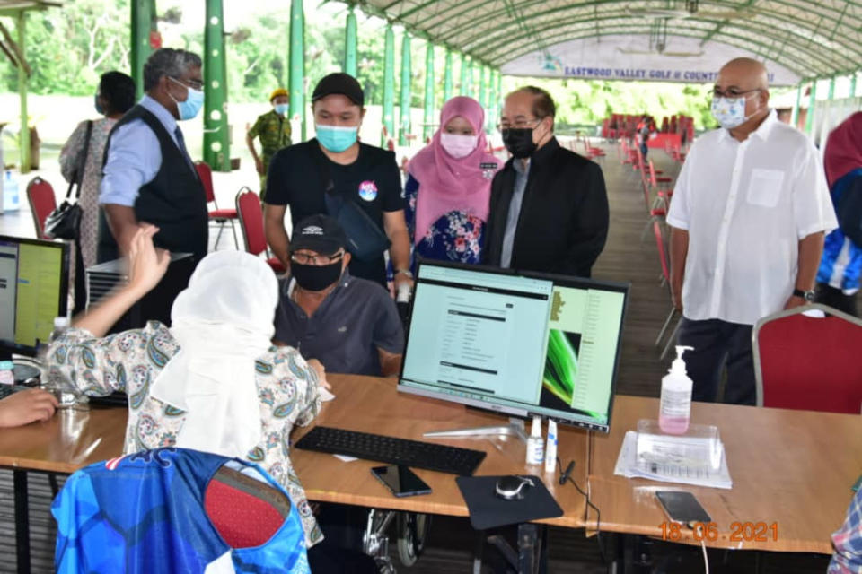 File picture shows Sarawak Deputy Chief Minister Datuk Amar Douglas Uggah observing the registration process for Covid-19 vaccination at Eastwood Valley Golf and Country Club in Miri, June 18, 2021. — Picture courtesy of the Deputy Minister's Office