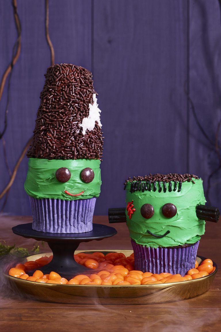 """<p>Place store-bought mini doughnuts on top of vanilla cupcakes to transform them into Halloween's favorite couple.</p><p><em><a href=""""https://www.womansday.com/food-recipes/food-drinks/a23570068/frankenstein-and-his-bride-cupcakes-recipe/"""" rel=""""nofollow noopener"""" target=""""_blank"""" data-ylk=""""slk:Get the Frankenstein and His Bride Cupcakes recipe."""" class=""""link rapid-noclick-resp"""">Get the Frankenstein and His Bride Cupcakes recipe.</a></em></p>"""