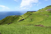 "The twin-island nation of St. Kitts & Nevis bursts at the seams with charm. But first: St. Kitts. The larger of the two islands is known for its sugarcane fields and well-preserved Brimstone Hill fortresses, best approached on the open-air train that runs along the island's southern coast. For sophisticated lodgings with a view, book a stay at <a href=""https://www.cntraveler.com/hotels/kittian-hill/belle-mont-farm?mbid=synd_yahoo_rss"" rel=""nofollow noopener"" target=""_blank"" data-ylk=""slk:Belle Mont Farm on Kittitian Hill"" class=""link rapid-noclick-resp"">Belle Mont Farm on Kittitian Hill</a>. Situated on the northwestern slopes of Mt. Liamuiga, some of the resort's biggest draws are the private plunge pools and outdoor clawfoot tubs overlooking the sea."
