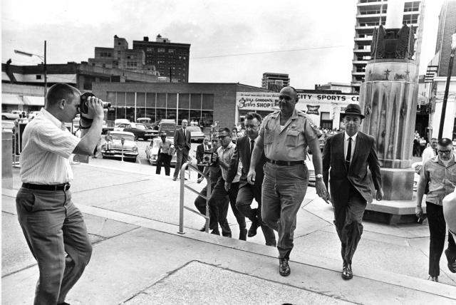 <p>Neshoba County Sheriff Lawrence Rainey, center, arrives at the Federal building between two FBI men as he is brought in to be arraigned before U.S. Commissioner on violating civil rights of three Freedom Summer workers in Meridian, Miss., Oct. 3, 1964. (Photo: Horace Cort/AP) </p>