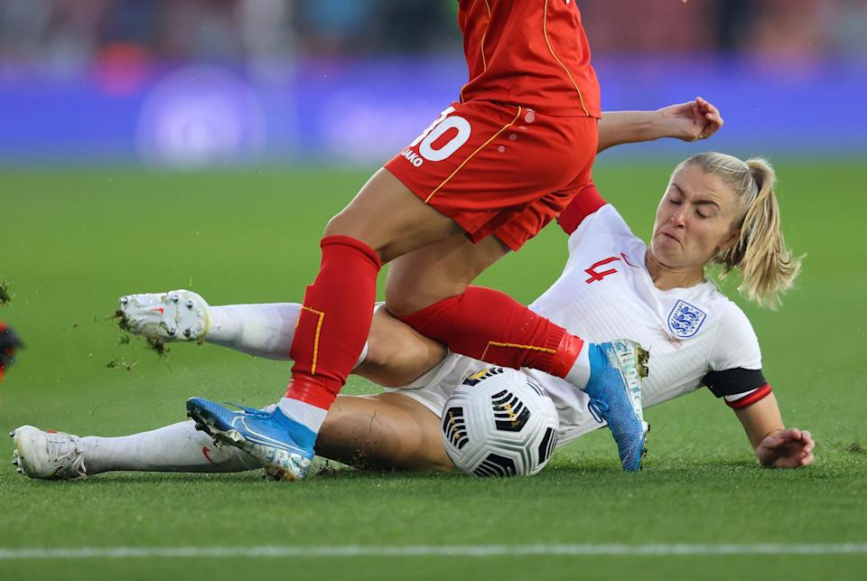 England's Leah Williamson makes a tackle during a World Cup qualifying match.