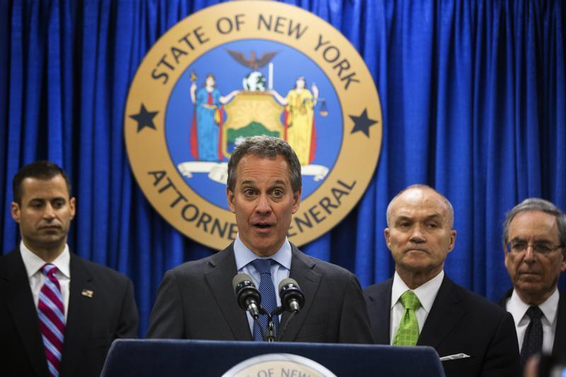New York Attorney General Schneiderman speaks at a news conference announcing an organized crime task force take down of an unstamped cigarette trafficking ring in New York