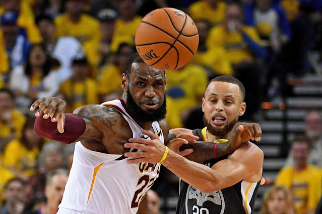 June 3, 2018; Oakland, CA, USA; Golden State Warriors guard Stephen Curry (30) and Cleveland Cavaliers forward LeBron James (23) go for a loose ball during the second quarter in game one of the 2018 NBA Finals at Oracle Arena. Mandatory Credit: Kyle Terada-USA TODAY Sports TPX IMAGES OF THE DAY