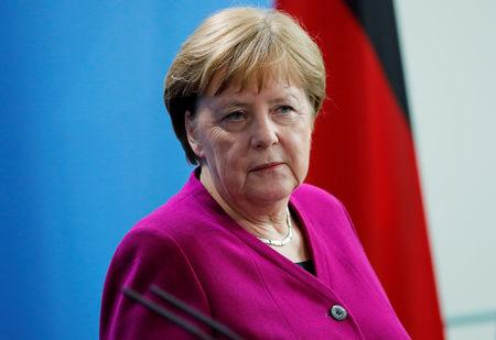 FILE PHOTO: German Chancellor Merkel looks on as she attends a news conference at the Chancellery in Berlin